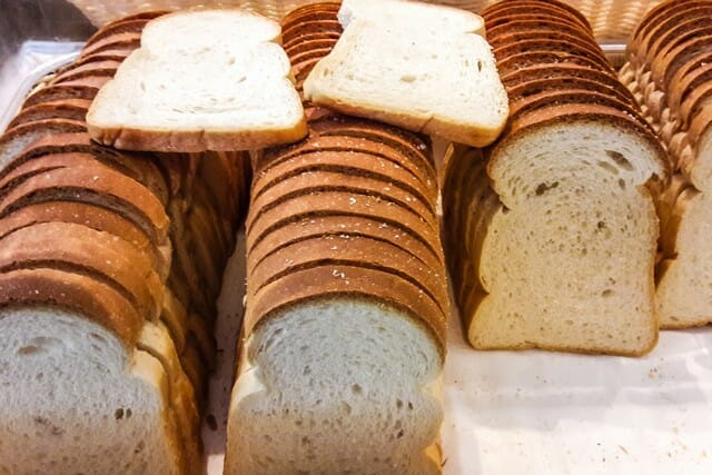 Adding bread is part of a long list of things that can be composted, which produce good bacteria with no health risk.