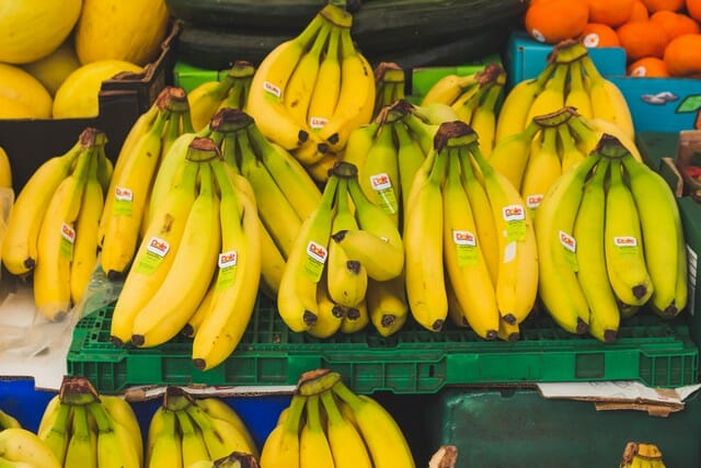 You need to remove the labels from the banana skins before composting.